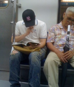 Korean Guy Wearing Baseball Cap on Train